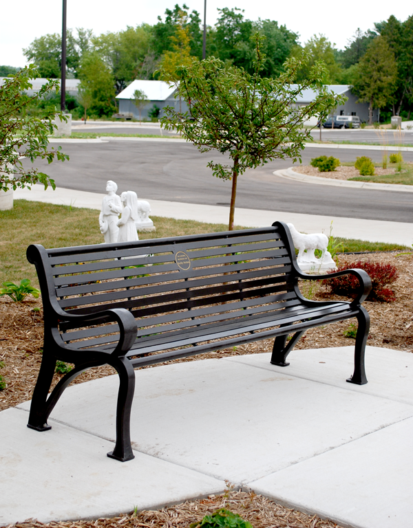 Example of an outdoor memorial bench with plaque.